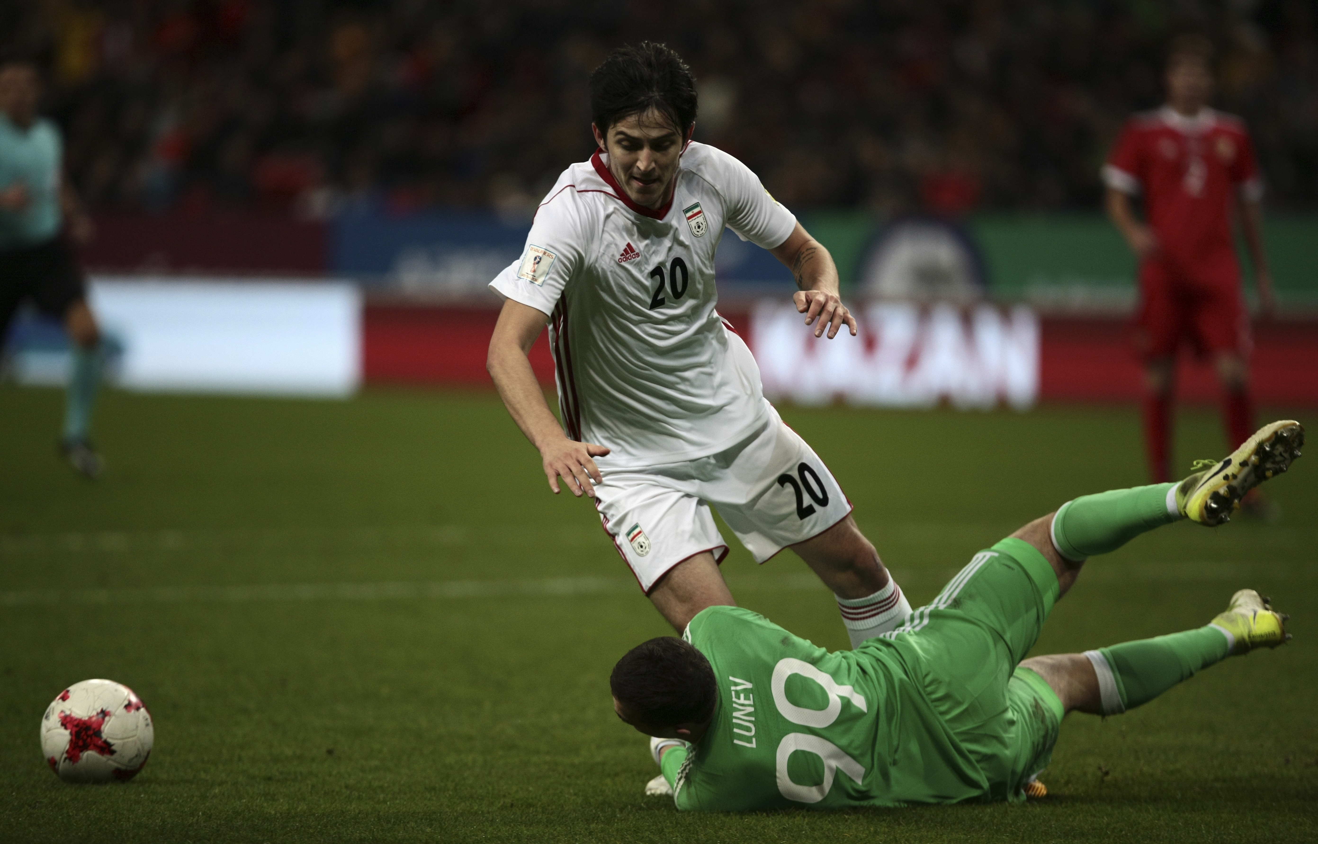 Iran's Sardar Azmoun plays in a football match against Russia