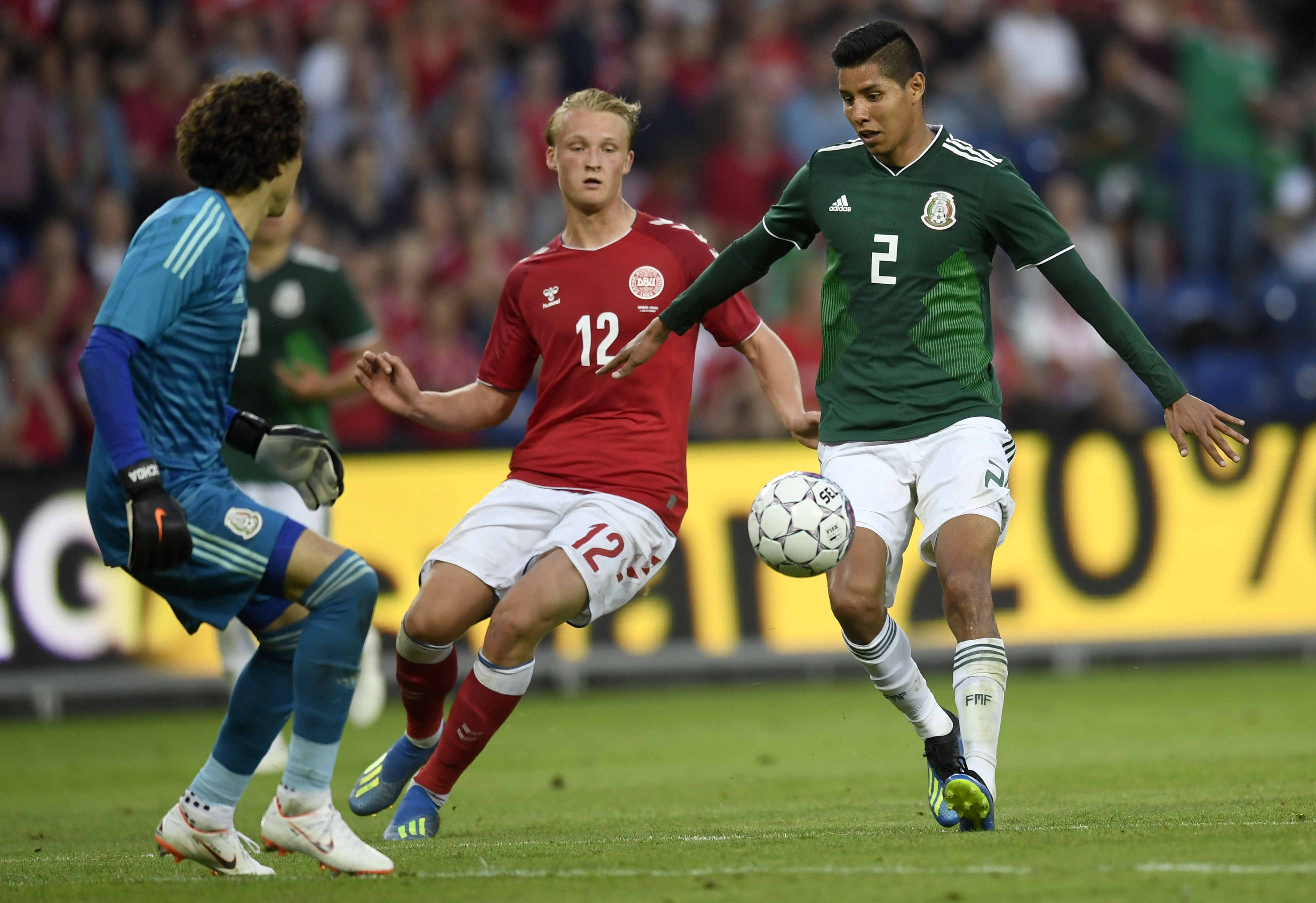 A football match between Denmark and Mexico