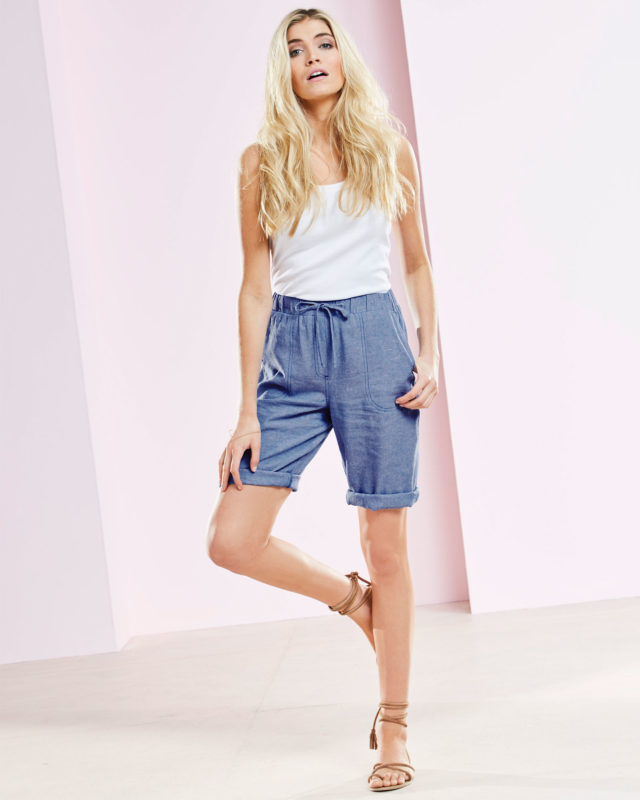 model wearing Cotton Edits White Wrinkle Free Vest and Linen-blend Shorts