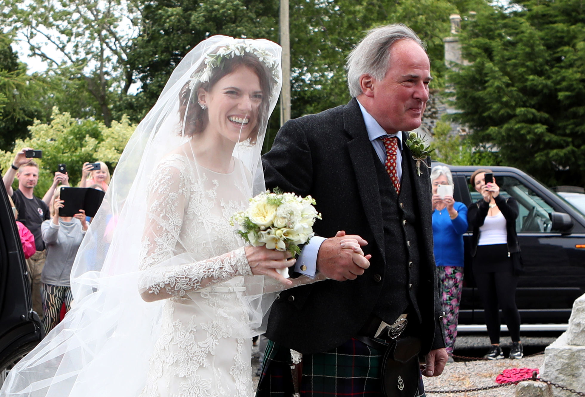 Rose Leslie with her father Sebastian arrive at church