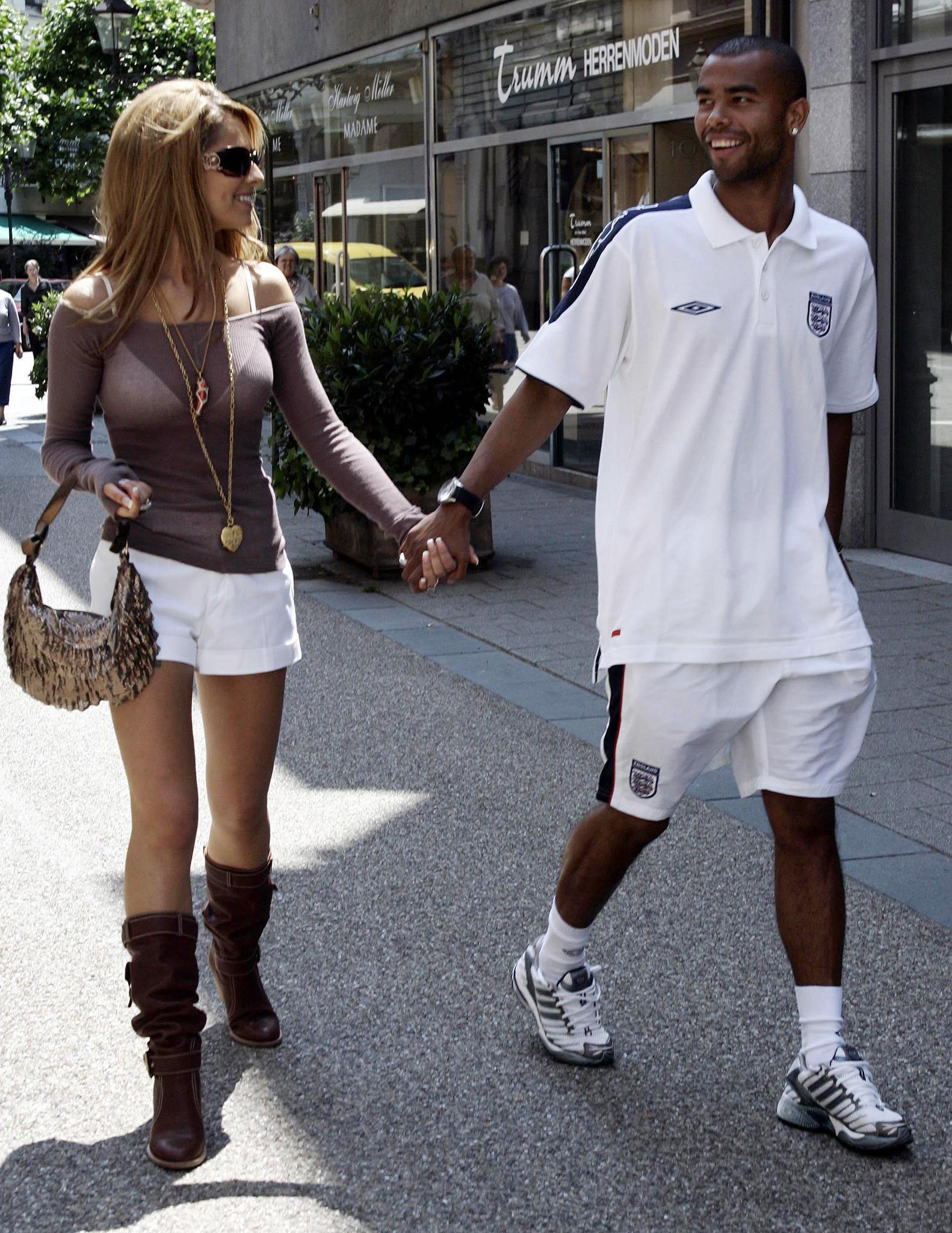 England footballer Ashley Cole with partner Cheryl Tweedy in the centre of Baden-Baden, Germany,