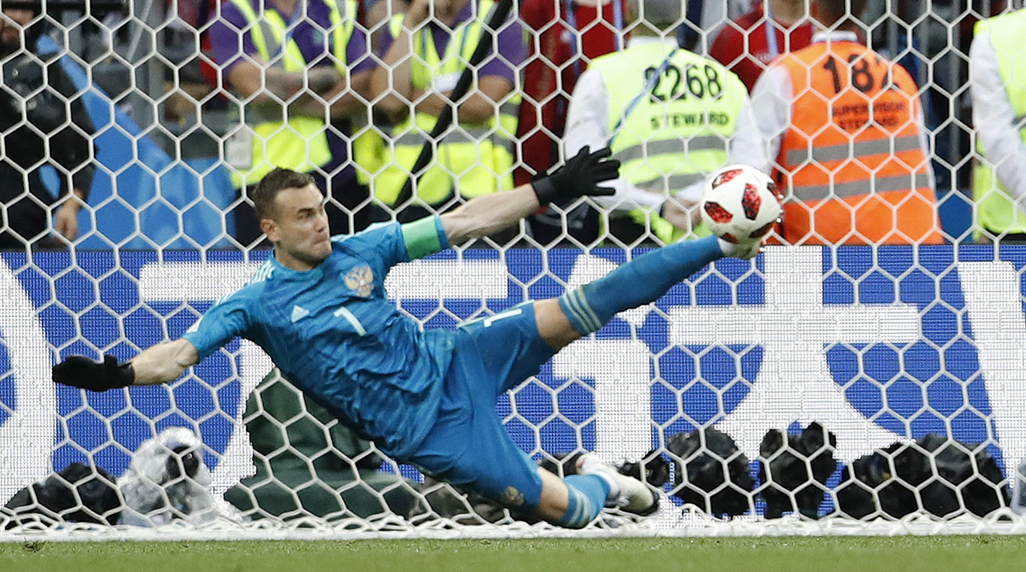 Russia goalkeeper Igor Akinfeev saves a penalty against Spain at the 2018 World Cup