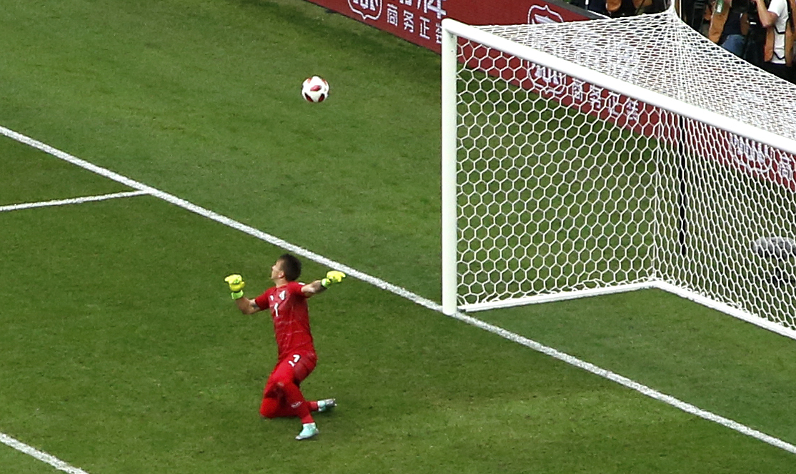 Muslera watches the ball fly into his net