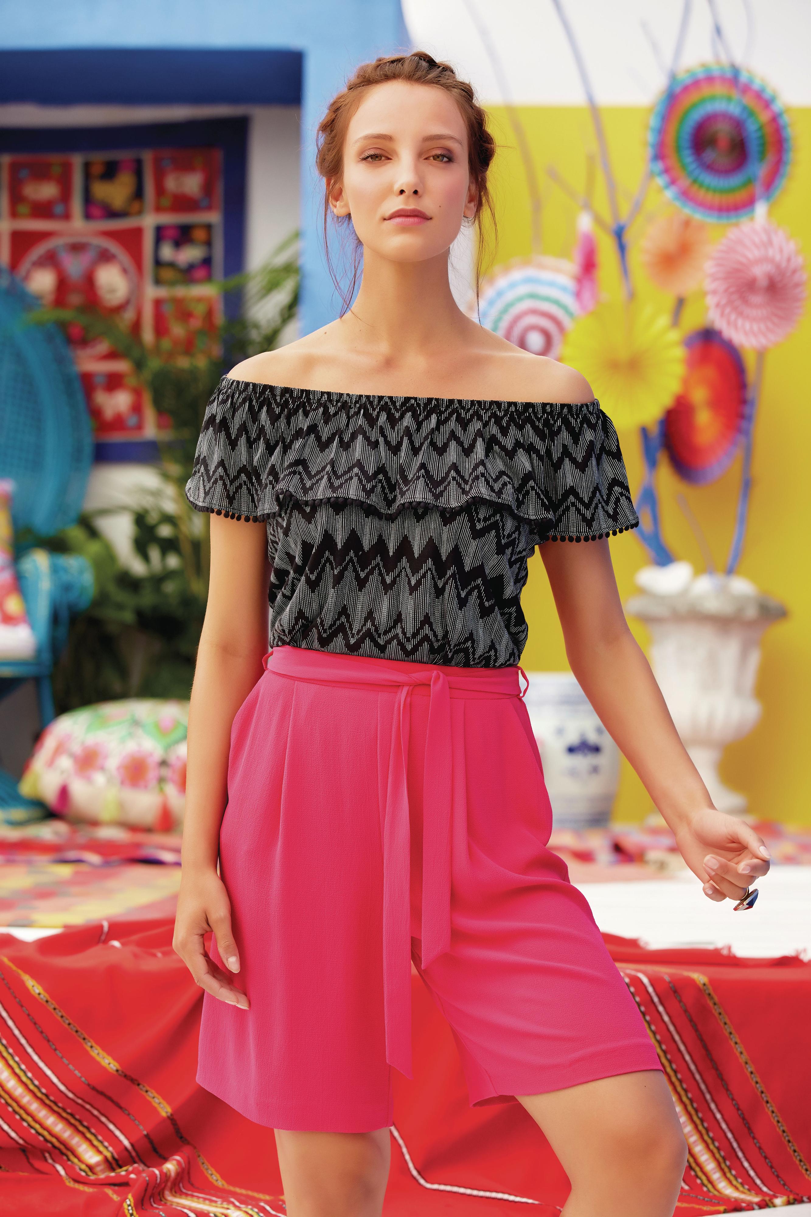 model wearing M&Co Chevron Print Frill Layer Bardot Top and Pink Tie Waist Shorts