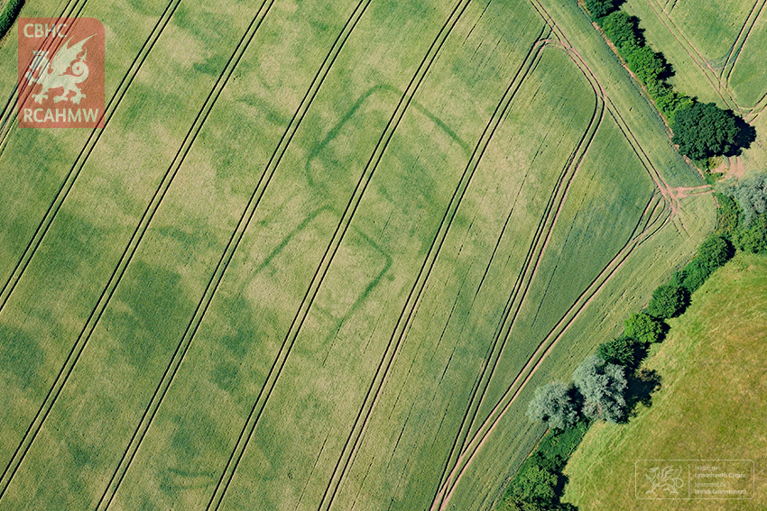 Newly discovered cropmarks of a prehistoric or Roman farm near Langstone, Newport, south Wales. (RCAHMW)