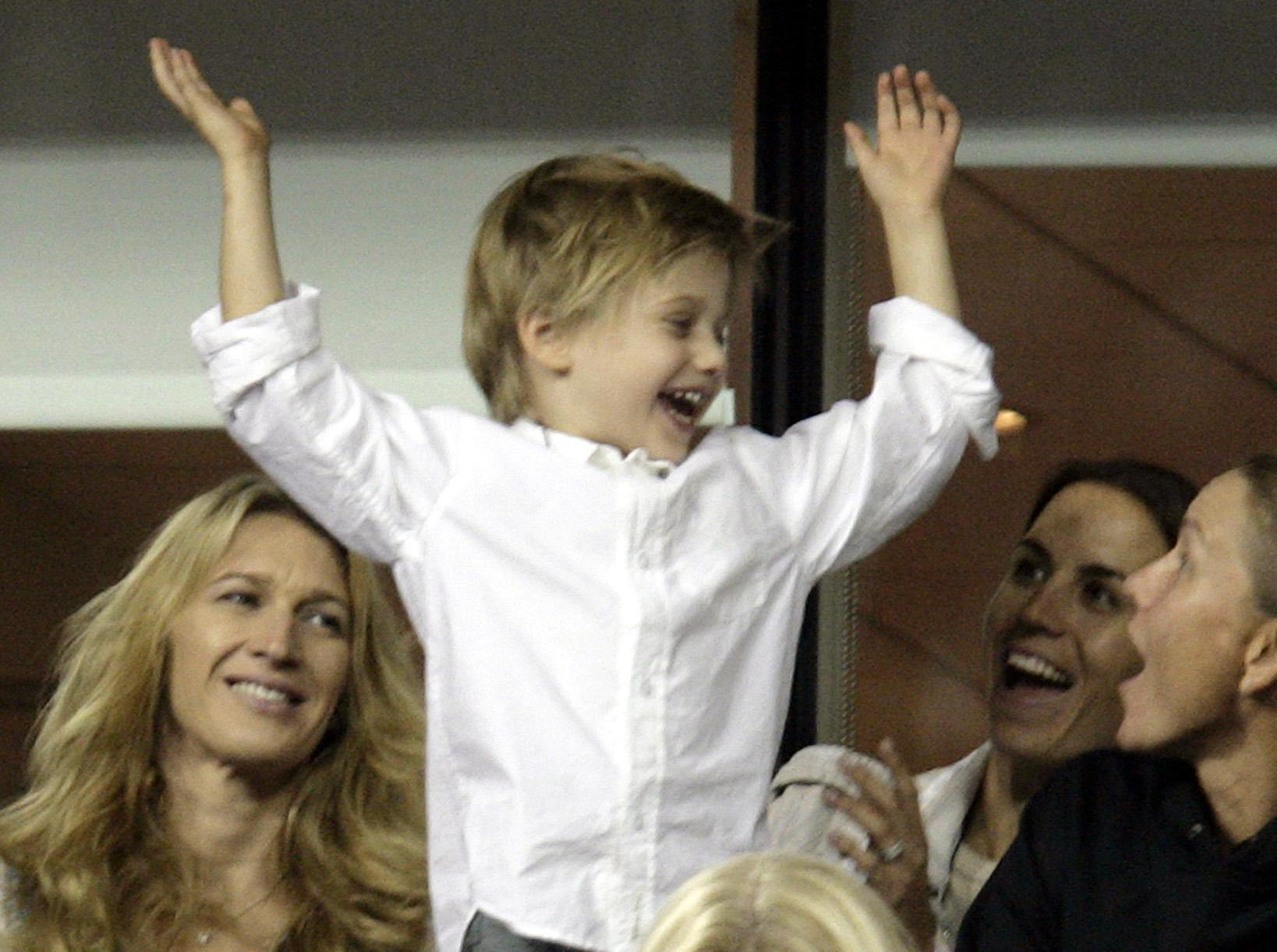 Andre Agassi's son Jaden Gil celebratIING with his mother, Steffi Graf (left), after USA's Andre Agassi beat Marcos Baghdatis in their second round match at the US Open in Flushing Meadow, New York IN 2006. (PA)