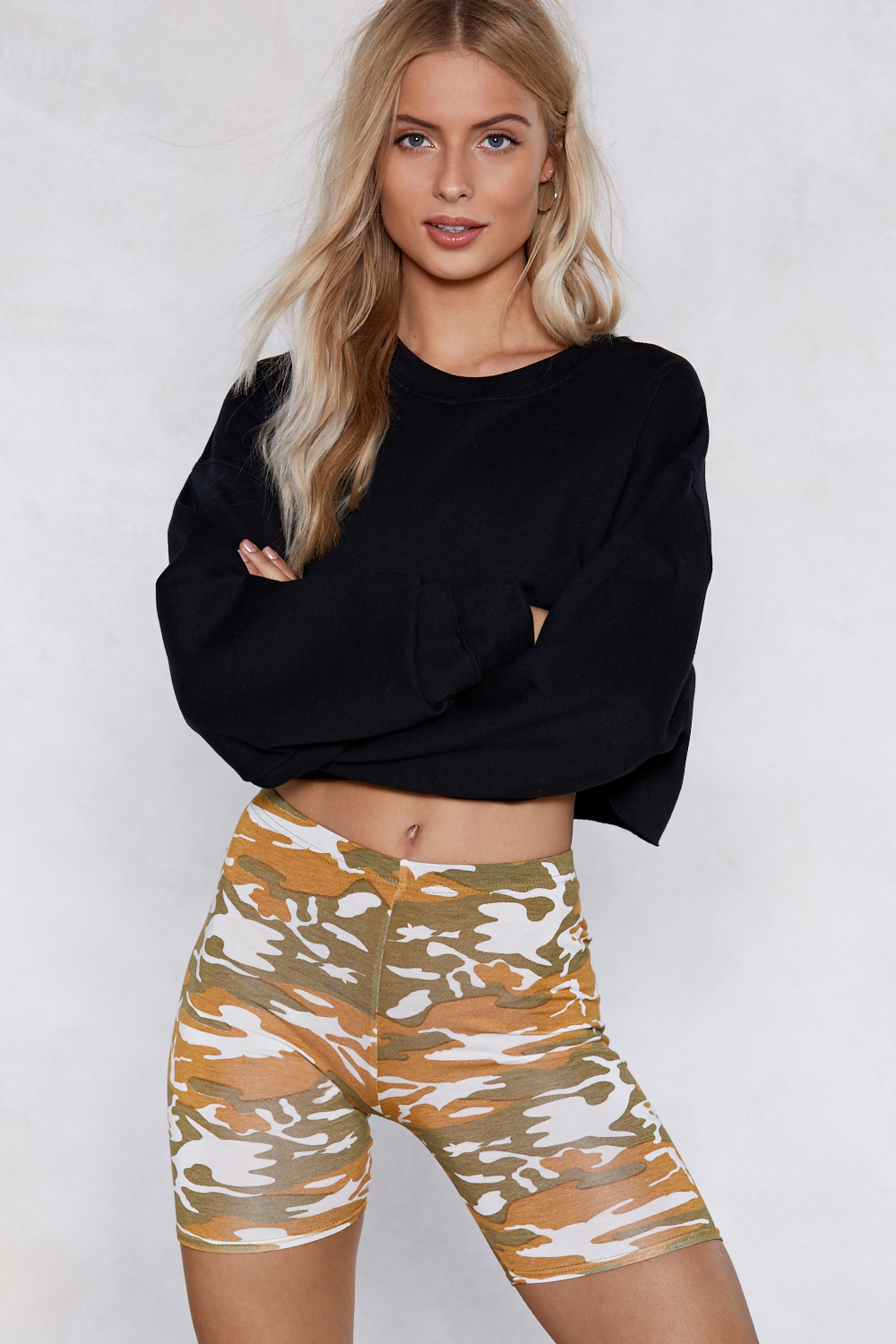 model wearing Nasty GalSit Back Cropped Sweater and Stand to Attention Camo Shorts