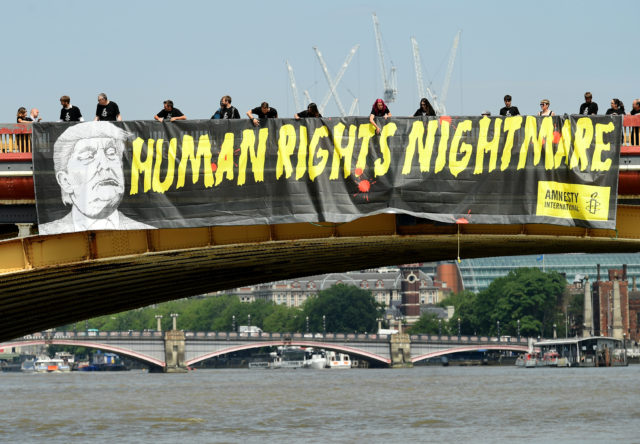 Amnesty International unveil a banner on the Vauxhall Bridge in London in protest against the visit of US President Donald Trump to the UK