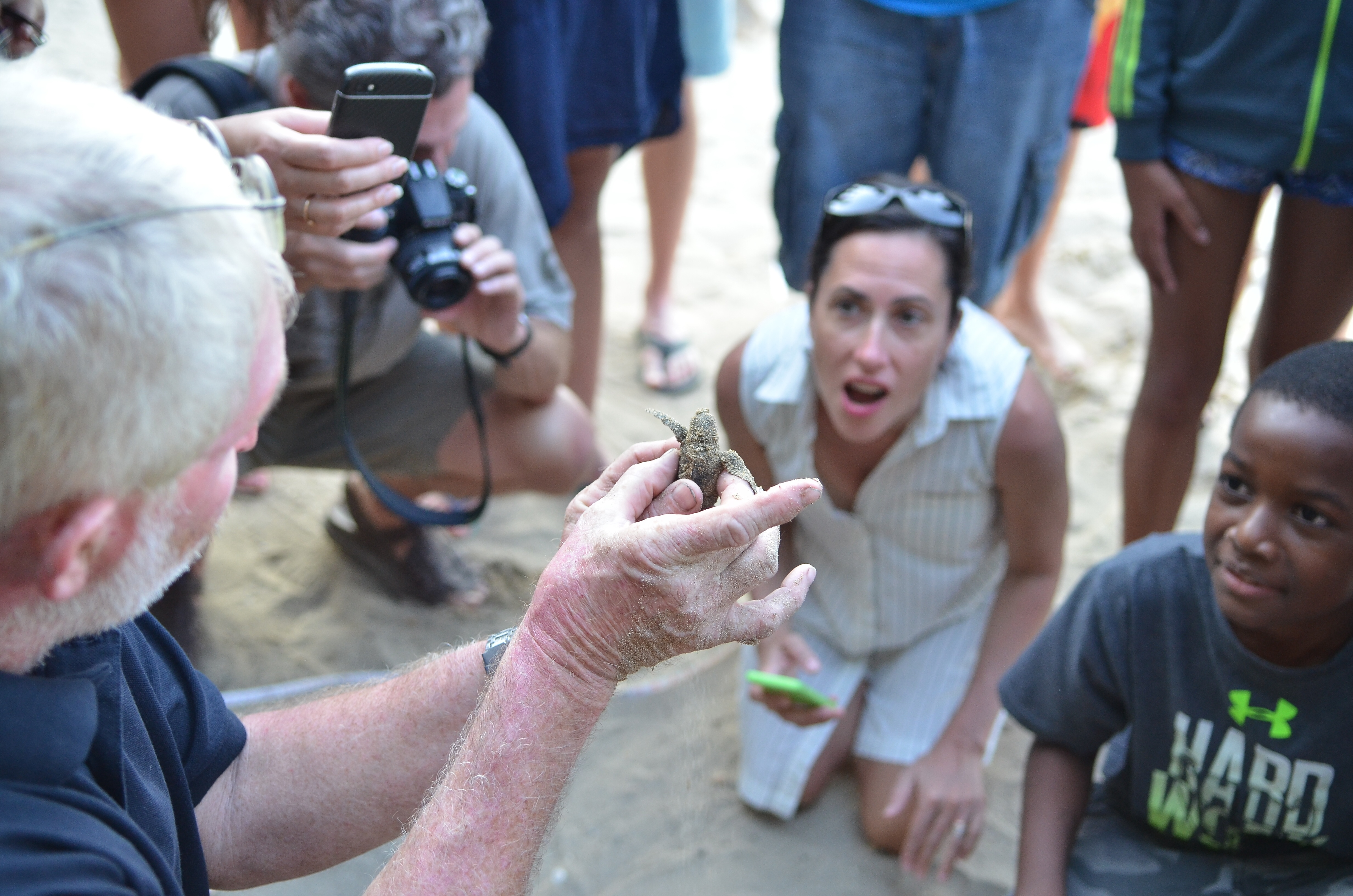 Melvyn Tennant with a baby turtle (Melvyn Tennant/PA)