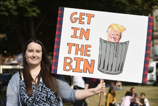 Trump arrives in Scotland amid protests
