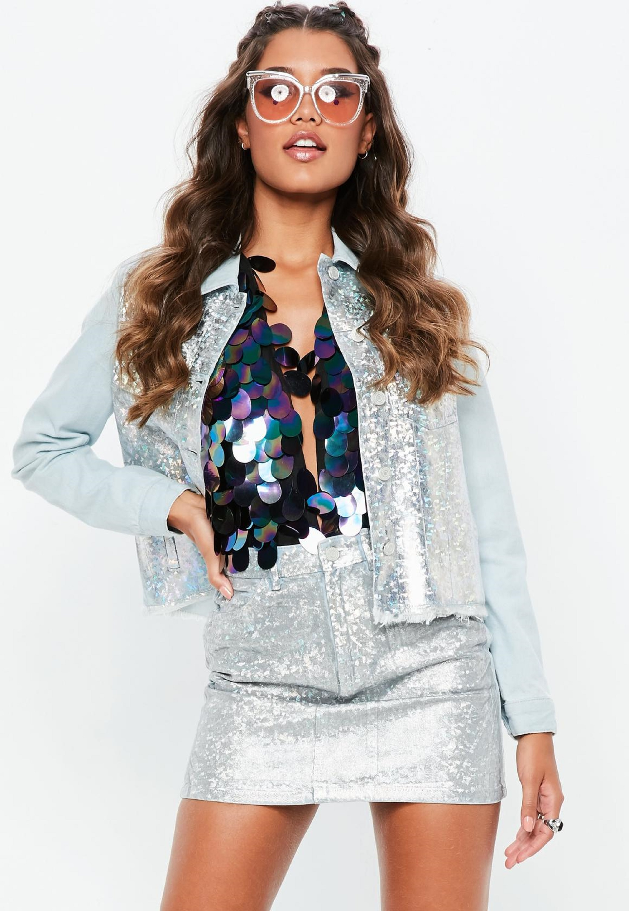 model wearing Missguided Silver Iridescent Foil Finish Denim Jacket, and Skirt; Tall Black Mermaid Bodysuit
