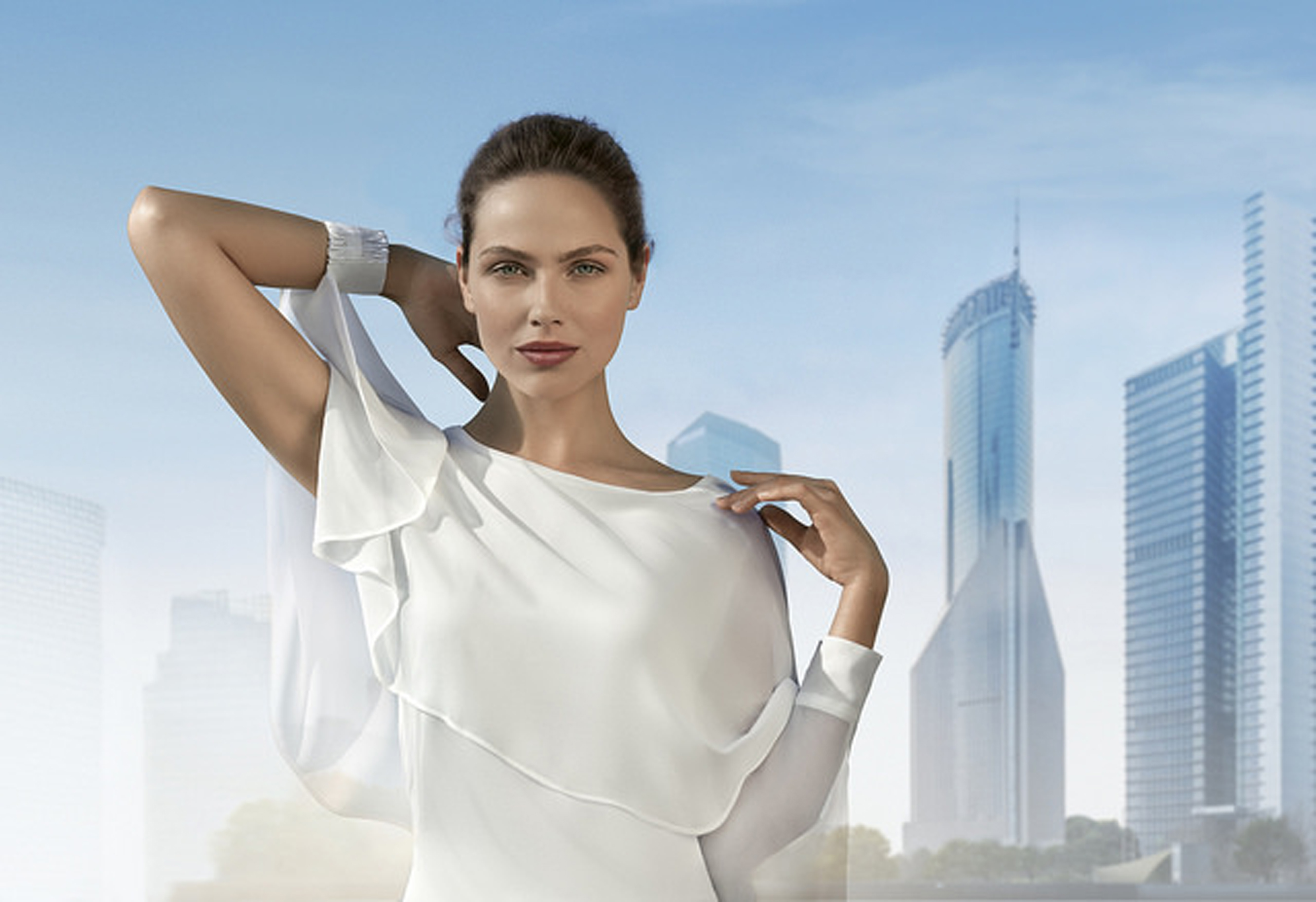 woman in front of a city skyline