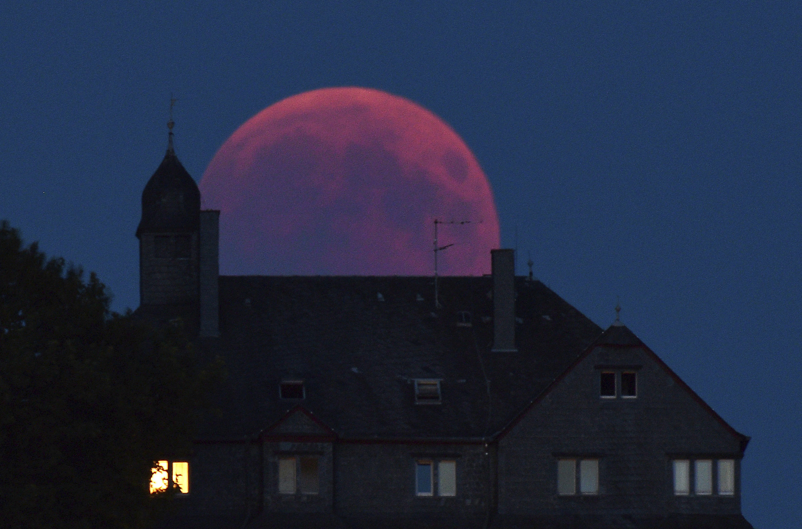 The moon turns red during a total lunar eclipse in Germany