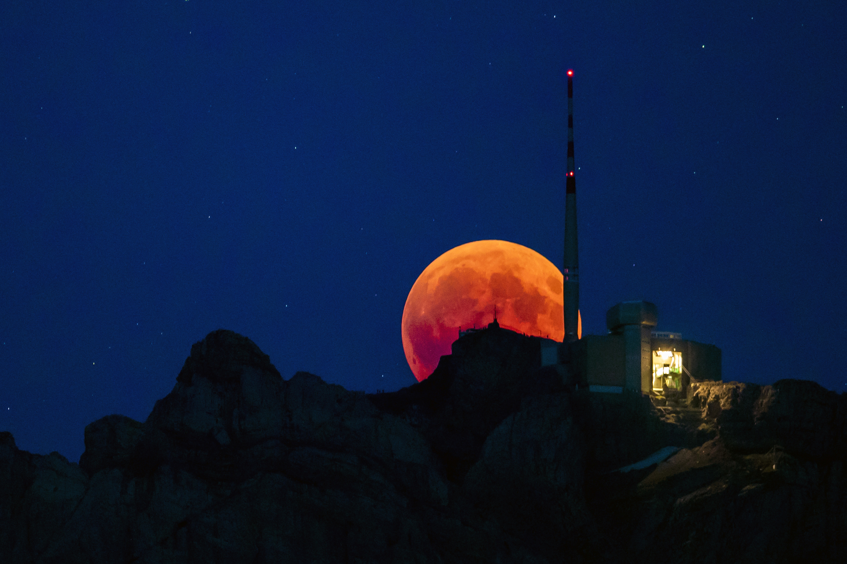 The moon turns red during a total lunar eclipse in Switzerland