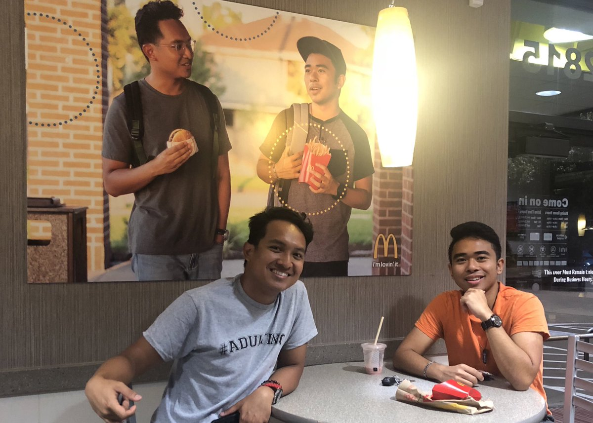 Jevh Maravilla and Christian Toledo with their picture in McDonald's