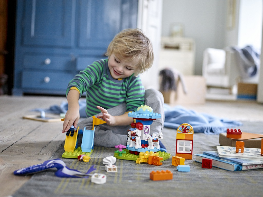 A liitle boy plays with Lego (LEGO DUPLO/PA)