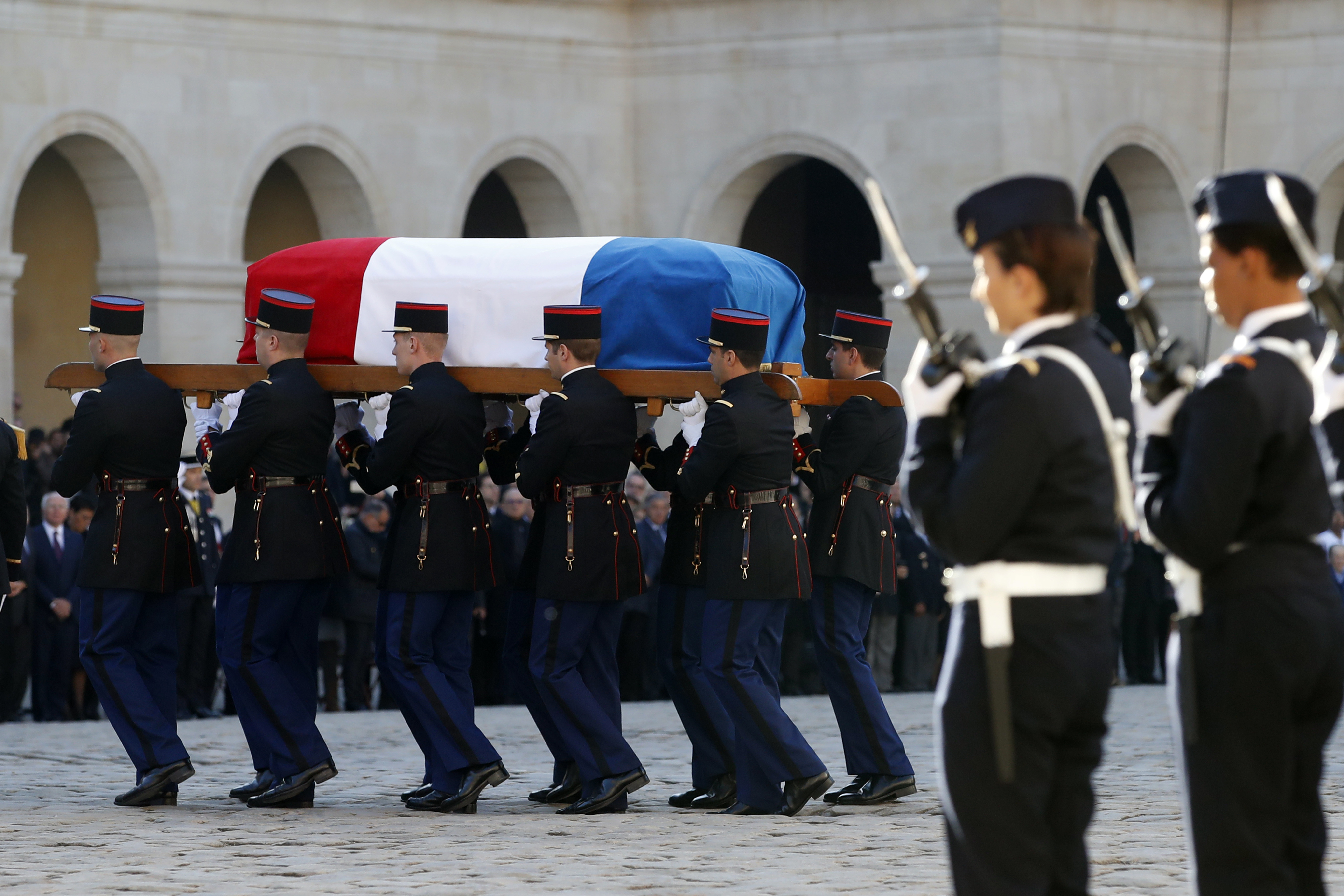 Soldiers carry the coffin of Charles Aznavour