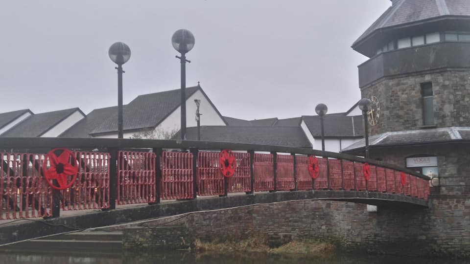 Knitted remembrance poppies decorate a bridge in Haverfordwest ahead of Armistice Day