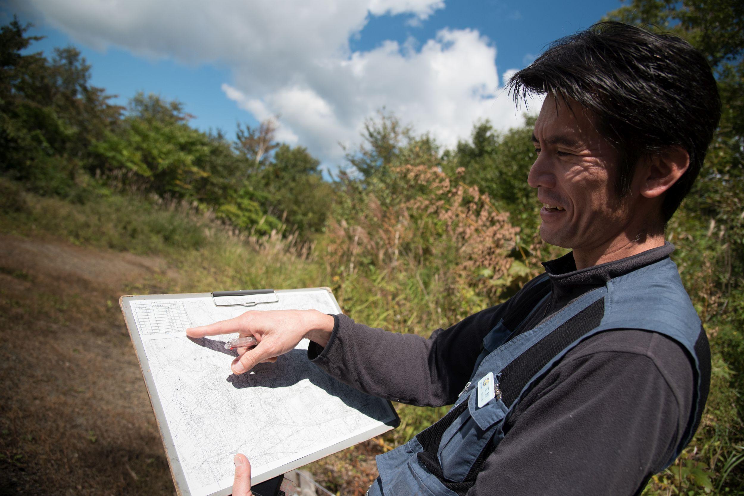 Tamatani researcher Hiroo records data from the Asian black bear (Sarah Marshall / PA)