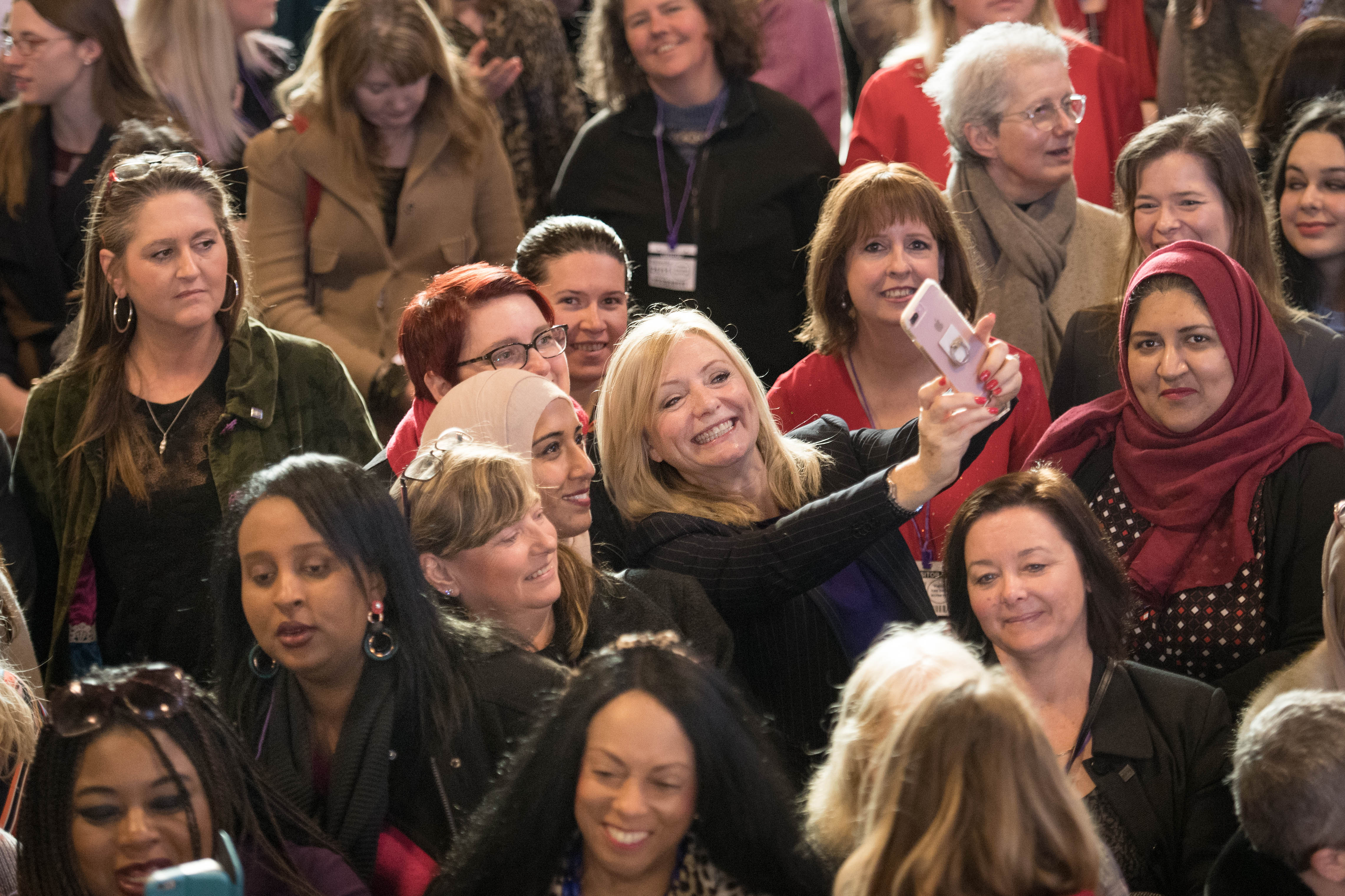 Labour MP Tracy Brabin takes a selfie as MPs from across the political spectrum gather alongside aspiring woman from their constituencies to show them the inner workings of Westminster.