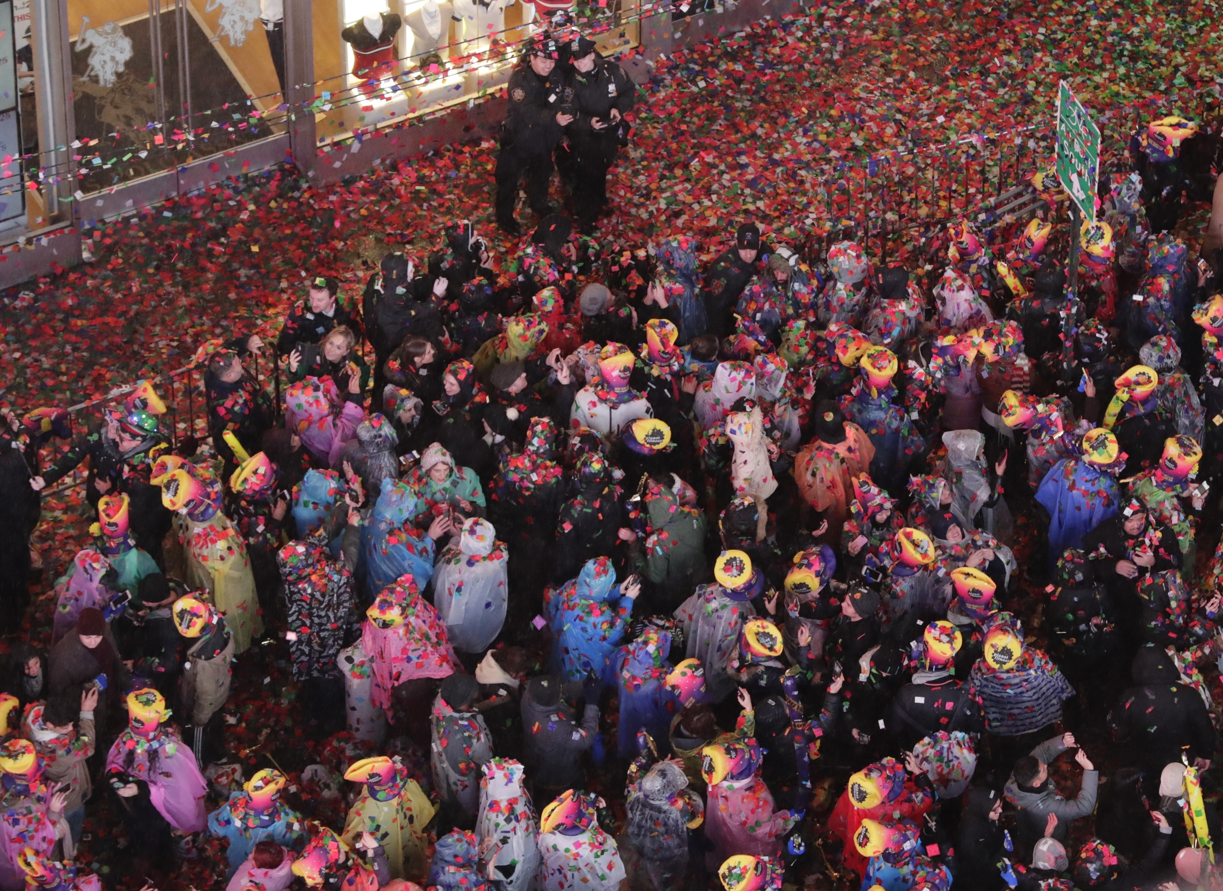 Confetti covers the crowd during the New Year's celebration in Times Square, New York