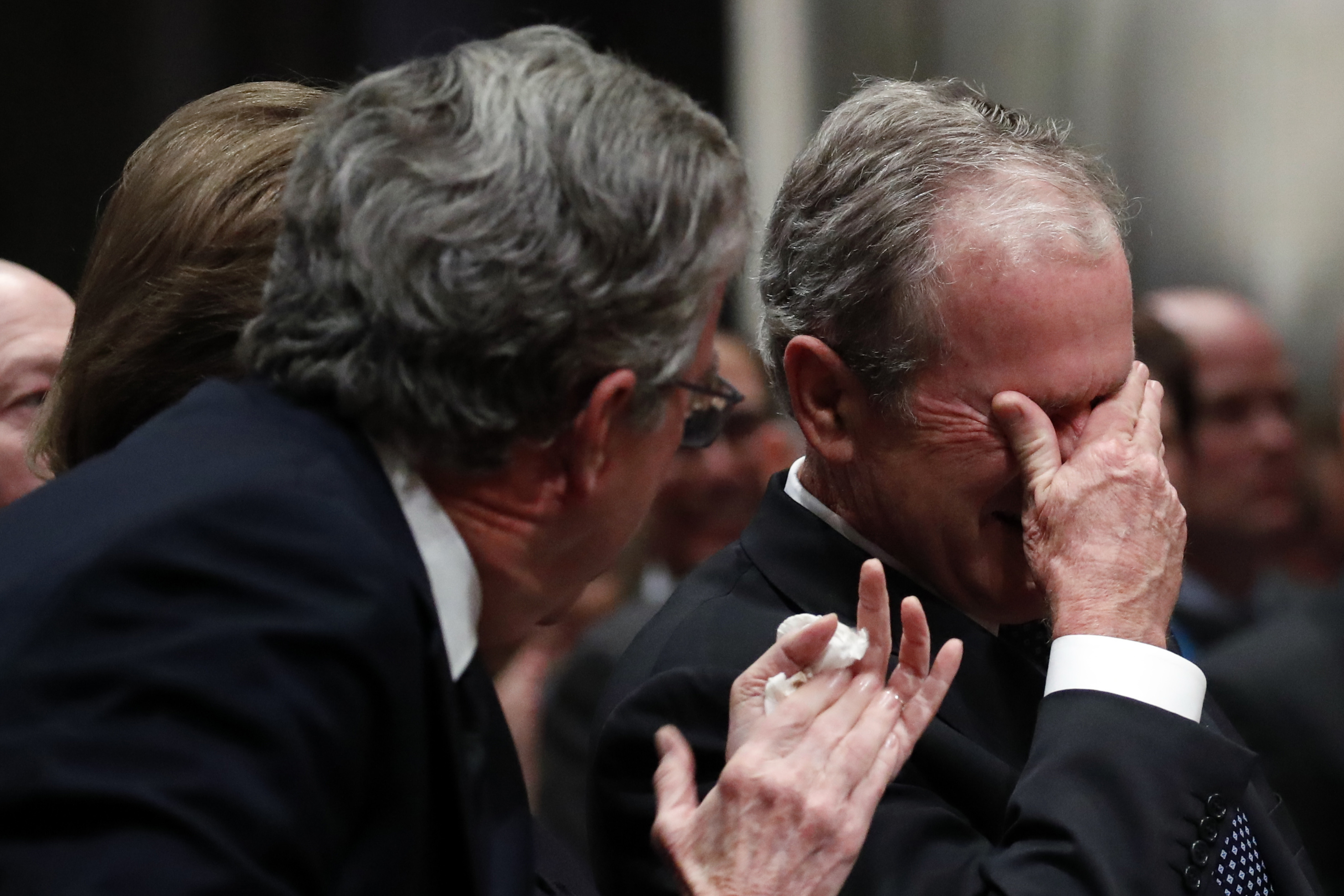 Former president George W Bush cries after speaking during the state funeral for his father