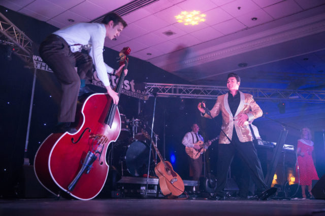 Mark Summer performing as Elvis with a band