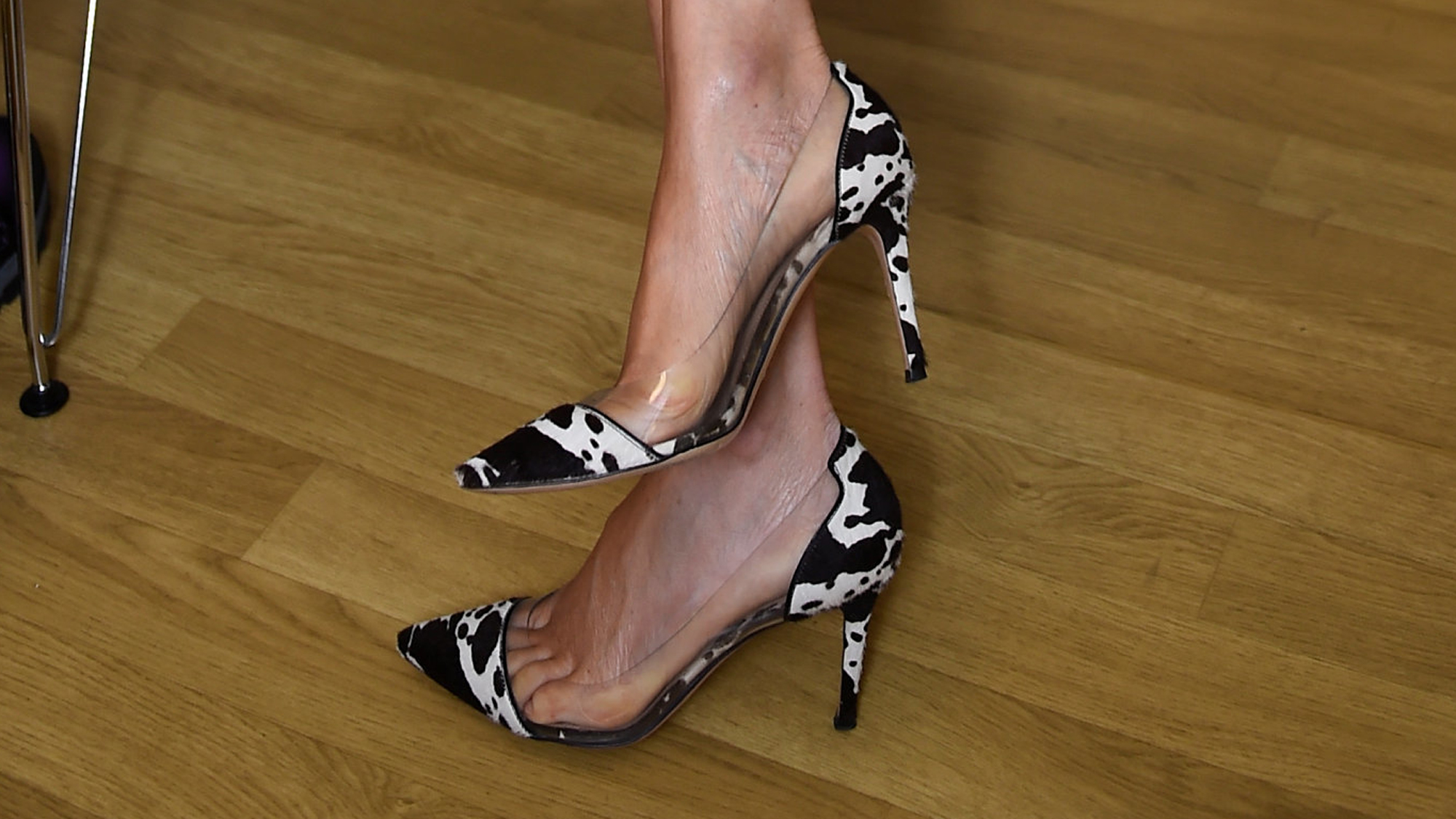 A close-up of Meghan's animal print heels