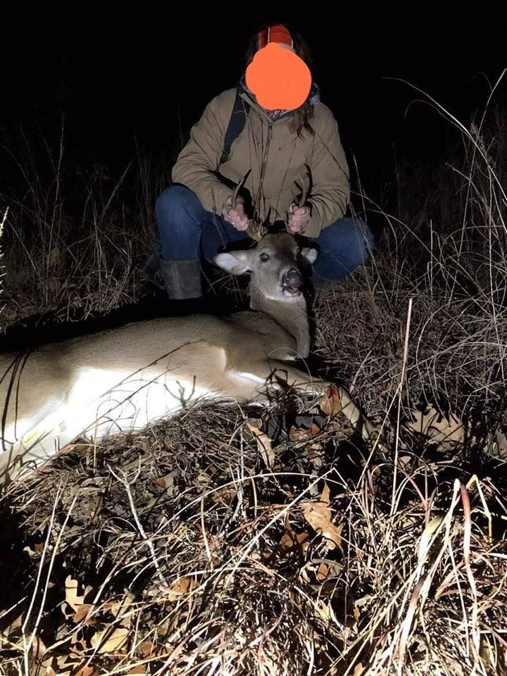 A poacher shows off a slain deer