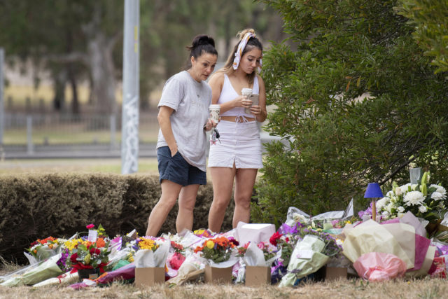 Floral tributes are left at the scene