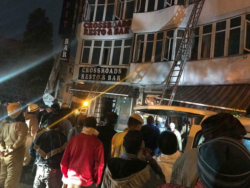 Firefighters rescue people during a fire at the Arpit Palace Hotel in New Delhi, India