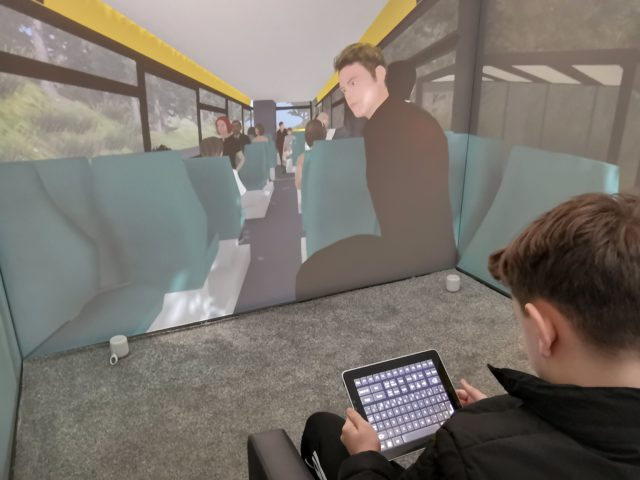 A child uses an iPad to navigate a scenario aimed at overcoming a fear of using public transport (Third Eye NeuroTech and Newcastle University/PA)