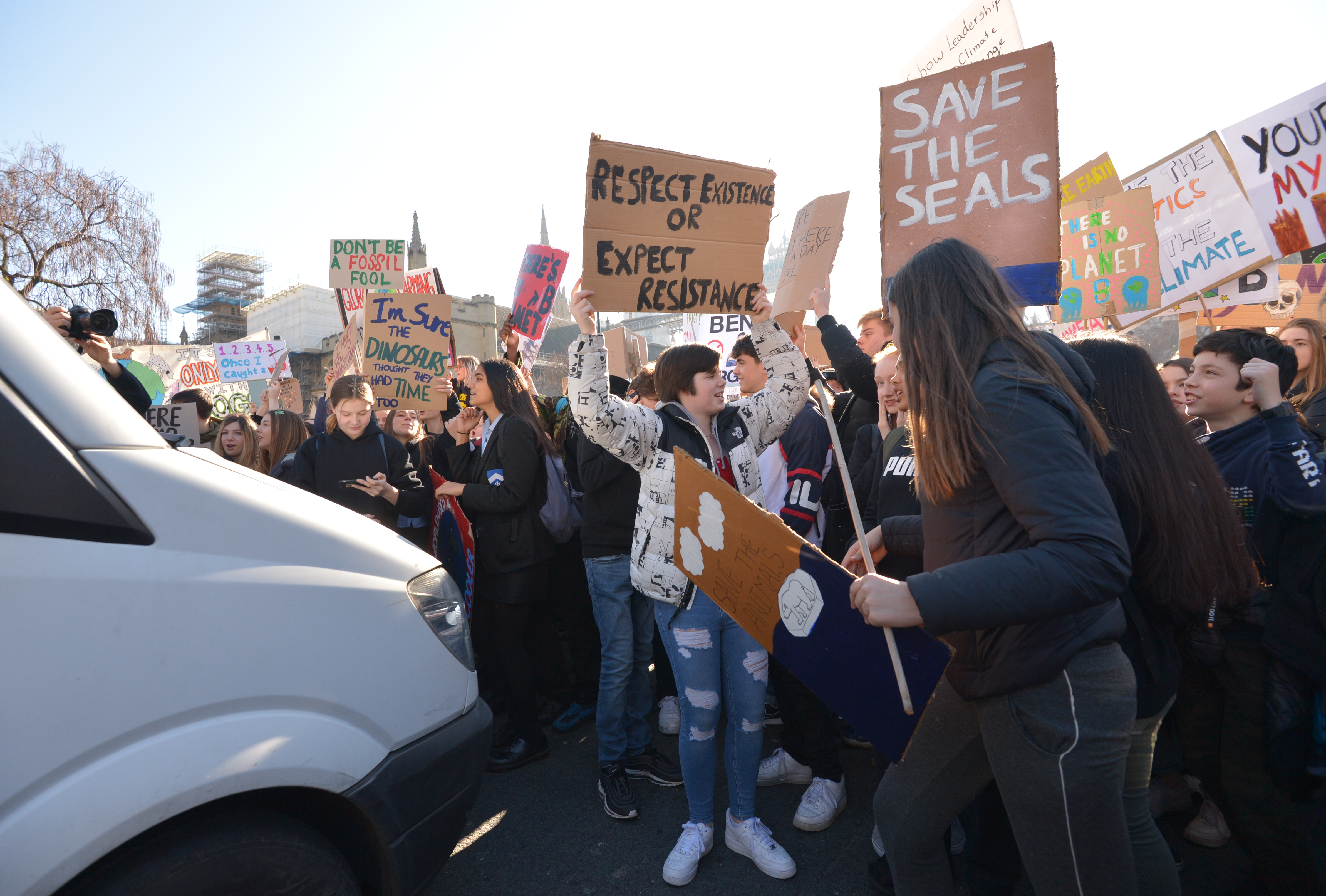 Students from the Youth Strike 4 Climate movement blocking traffic during a climate change protest on Parliament Square in Westminster, London