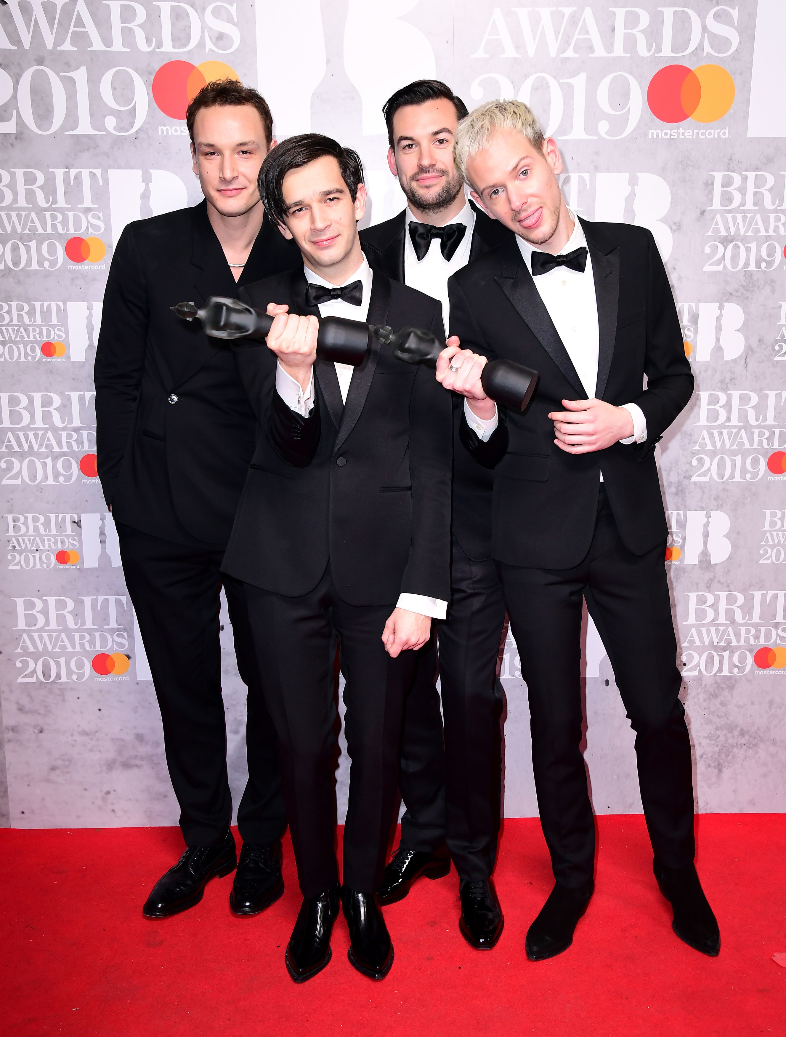 Matthew Healy, Ross MacDonald, George Daniel and Adam Hann of The 1975 with their Best British Group and Mastercard British Album of the Year Brit Awards
