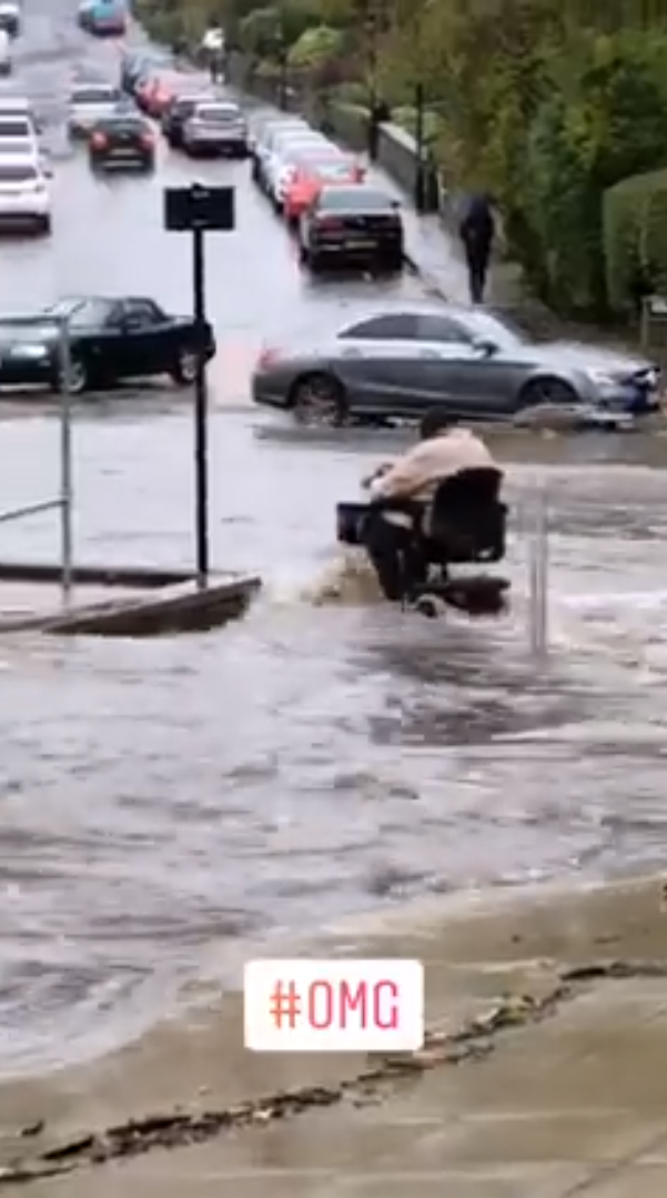 The woman driving through the floods