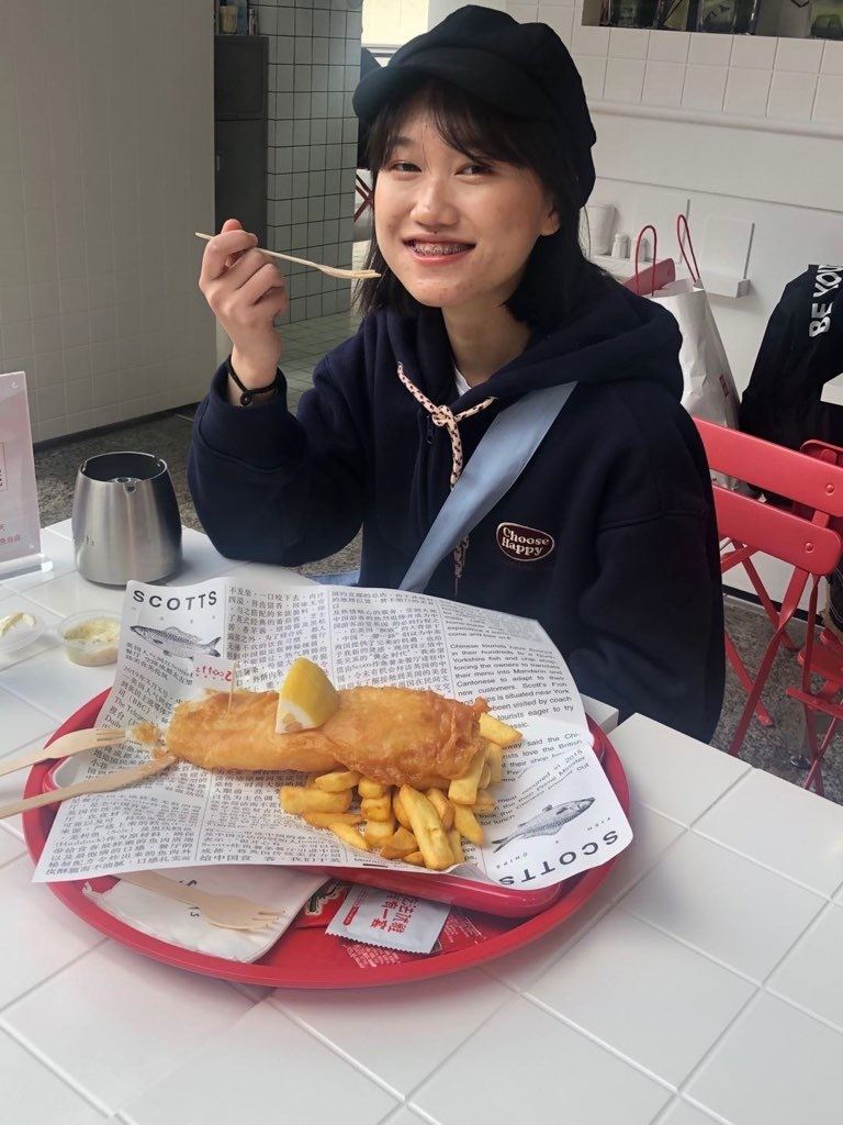 A customer enjoys fish and chips at Scotts in Chengdu
