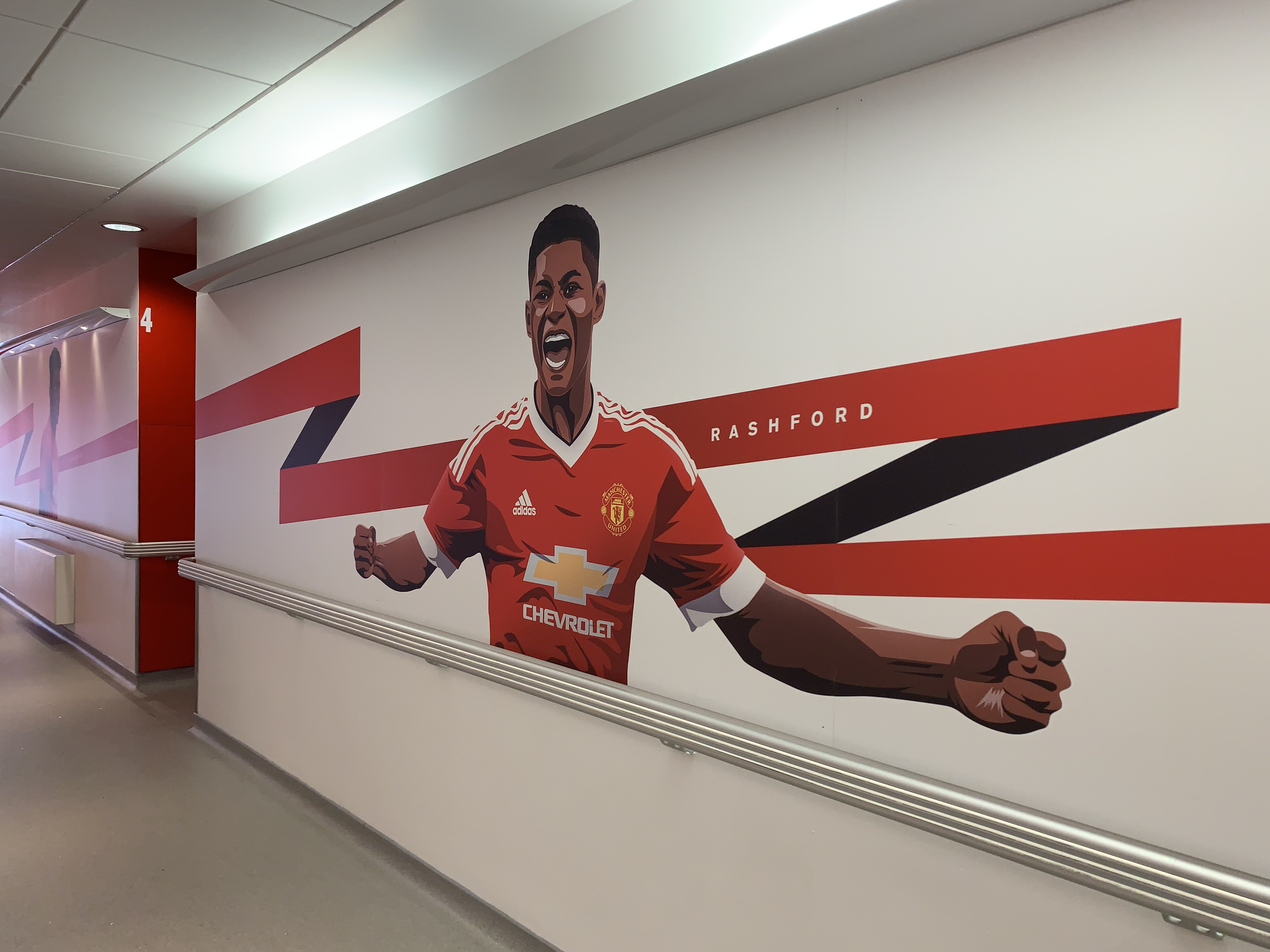 Image of Marcus Rashford on the wall at the Aon Training Complex