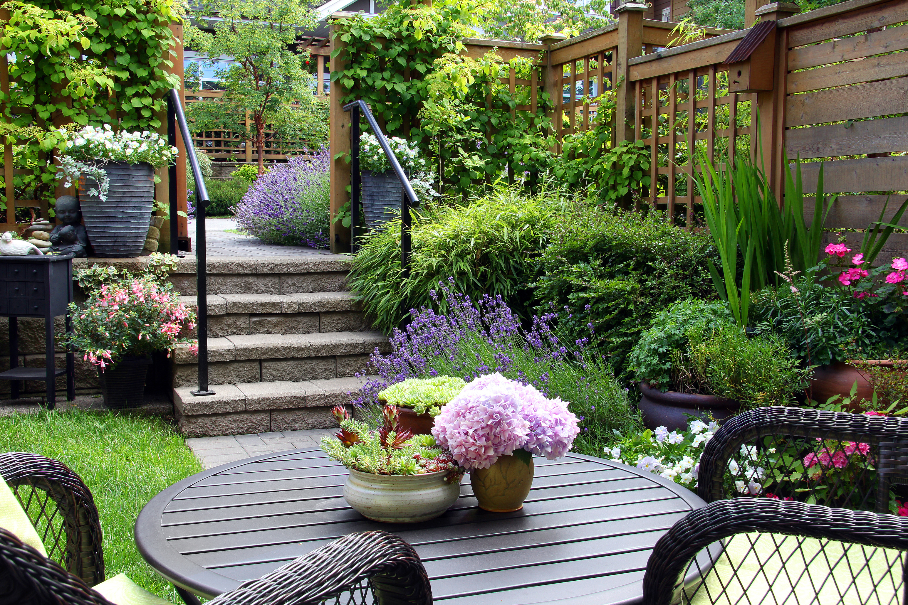 Use trellis and climbing plants to separate different areas of the garden (iStock/PA)
