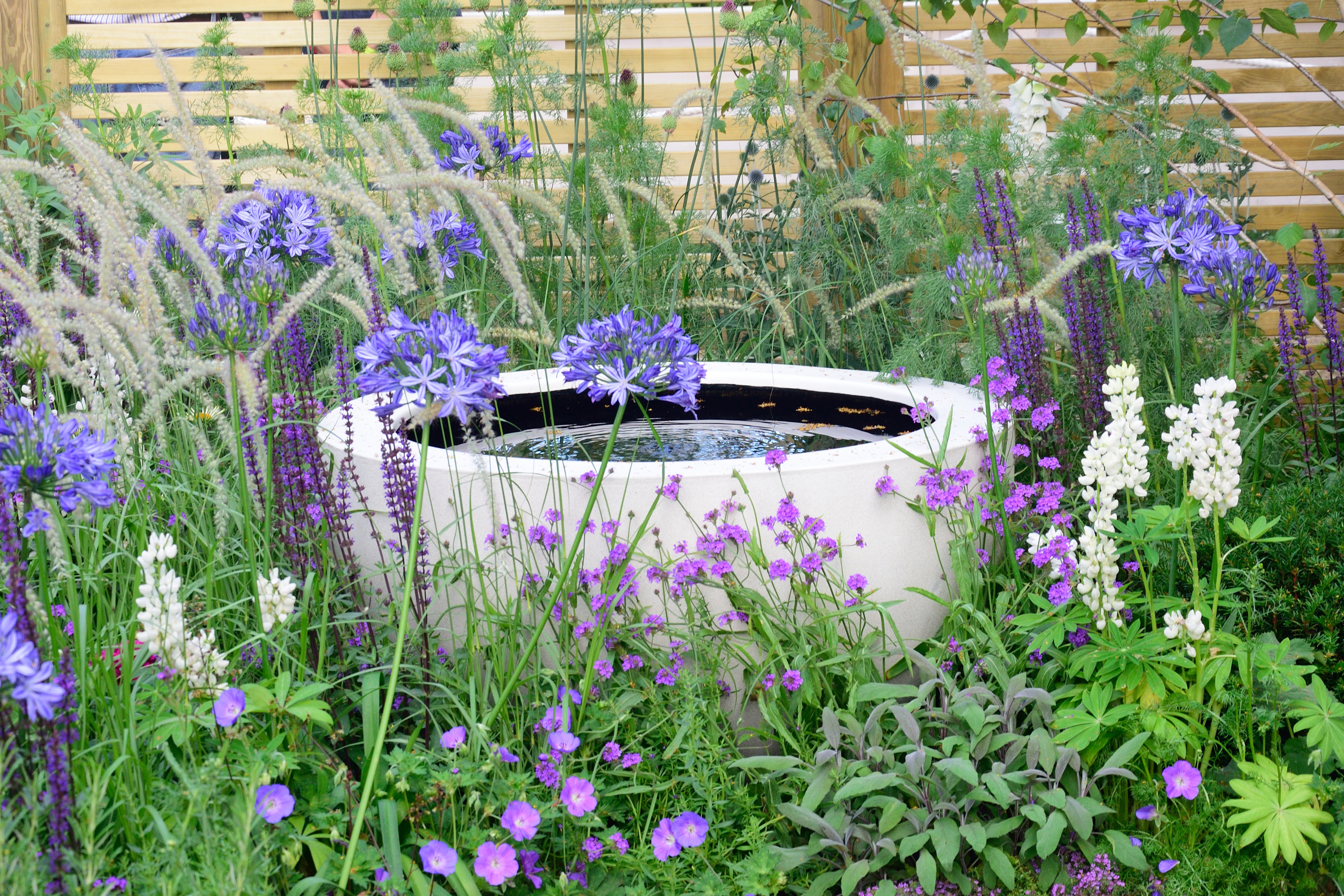 You can create eye-catching surprises like this water feature in odd-shaped gardens (iStock/PA)