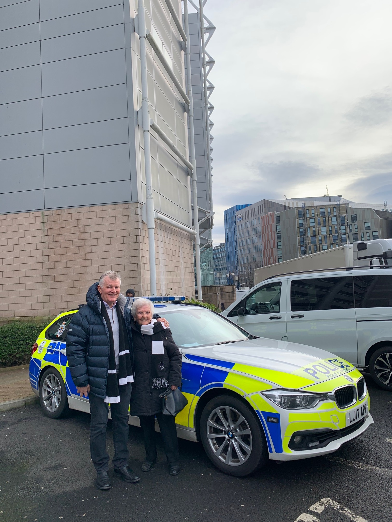 Florence Rudd, a lifelong Newcastle fan, stands next to a police car