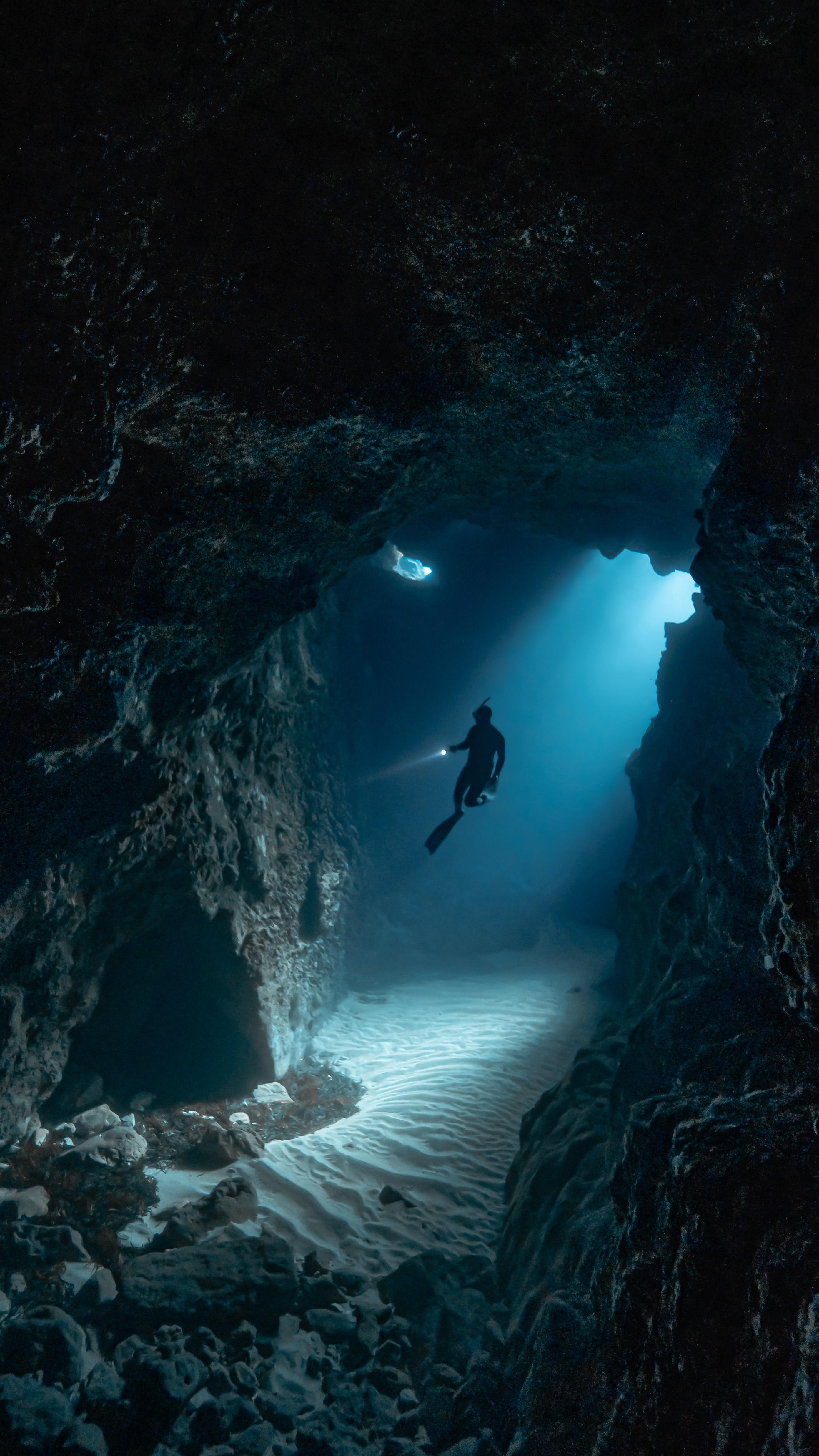 A free diver in an underwater cave network
