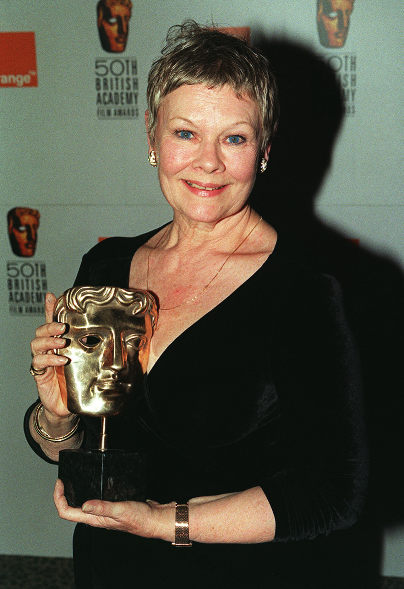 Judi Dench winning the best actress award for Mrs Brown at the 1998 Baftas