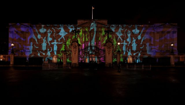 A projection designed by Studio Carrom, the Bangalore and London-based design studio, of a peacock and dancing figures on the facade of Buckingham Palace