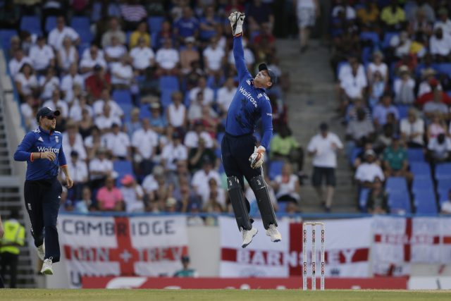 Jos Buttler leaps for a ball (Ricardo Mazalan/AP)