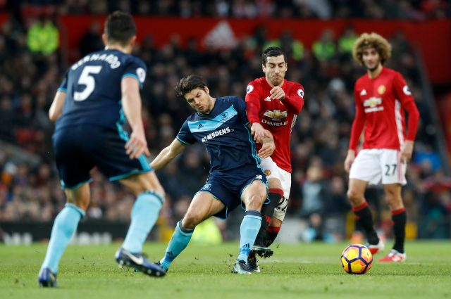 Middlesbrough's George Friend and Manchester United's Henrikh Mkhitaryan battle for the ball