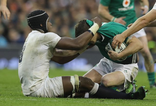 Johnny Sexton is tackled high by Maro Itoje  (Lorraine O'Sullivan/PA)
