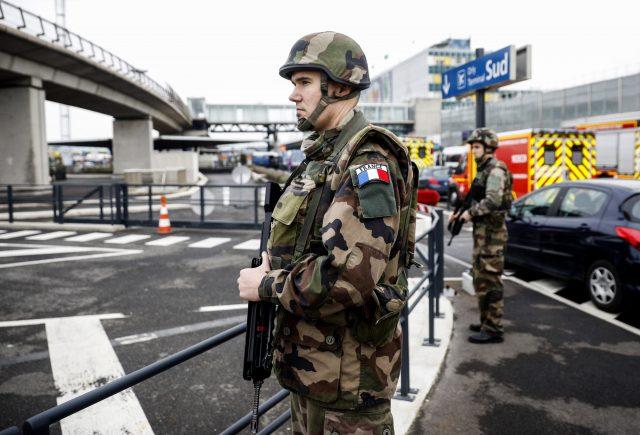 Soldiers patrol at Orly airport (Kamil Zihnioglu/AP)
