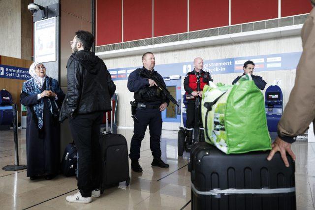 A riot police officer patrols inside the terminal (Kamil Zihnioglu/AP)