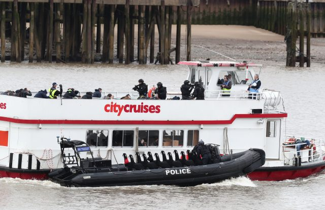 olice officers taking part in a multi-agency exercise on the Thames