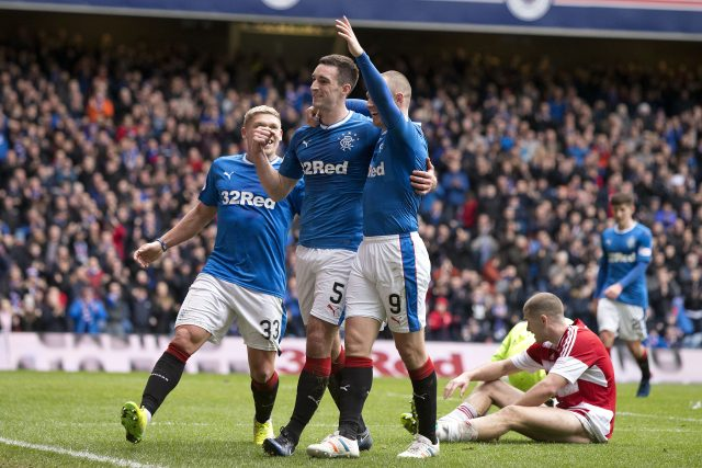 Lee Wallace, centre, celebrates scoring Rangers' fourth goal